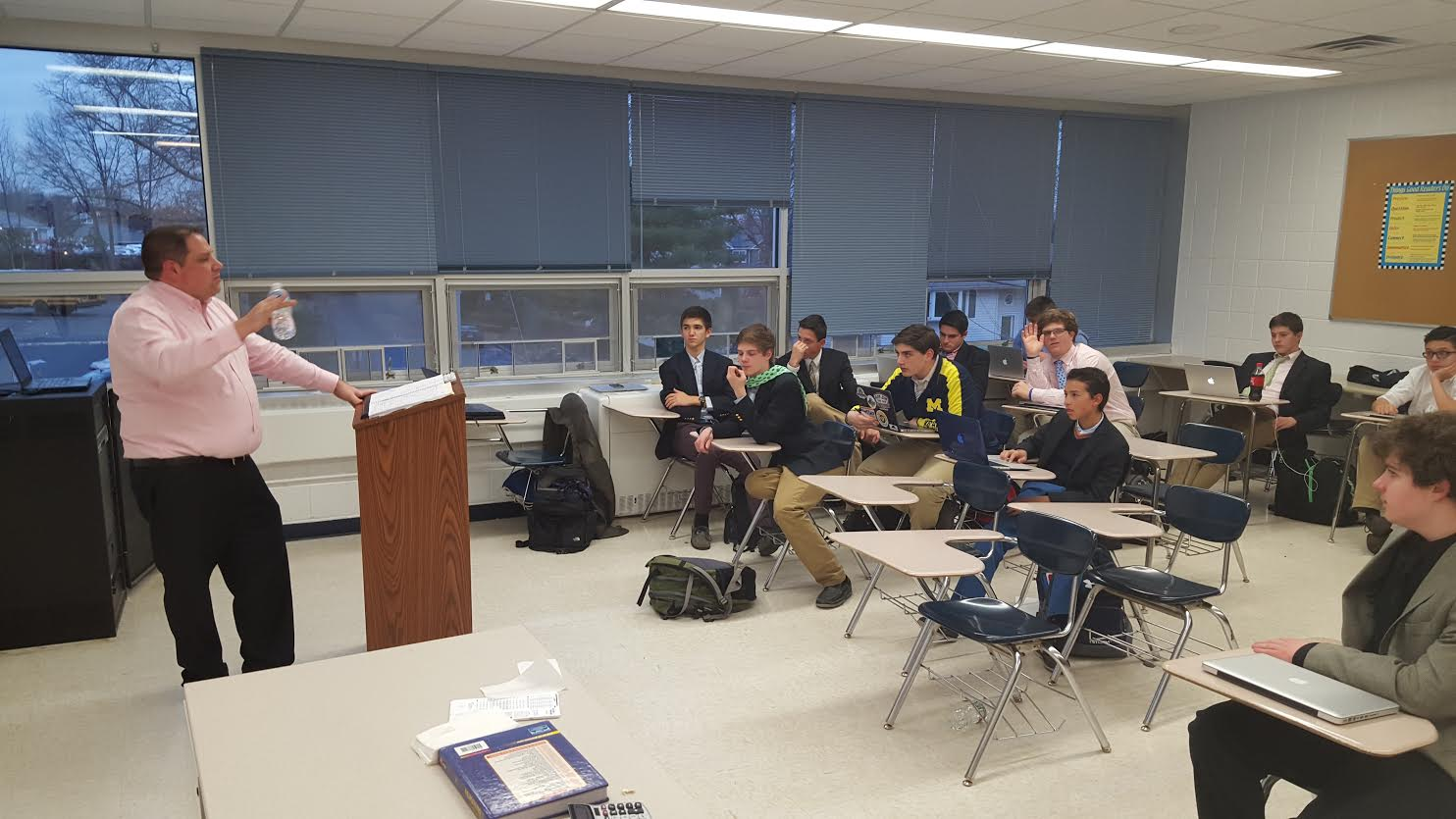 Mr. Martin prepares the Mock Trial boys for Counties (picture taken January 8).