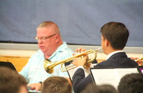 Music teacher Mr. Van Hoven plays the piano while senior Steven Fudenna plays the trumpet as part of the Music Ministry.