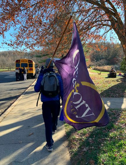 William Heffernan carries the Oratory flag after the meet