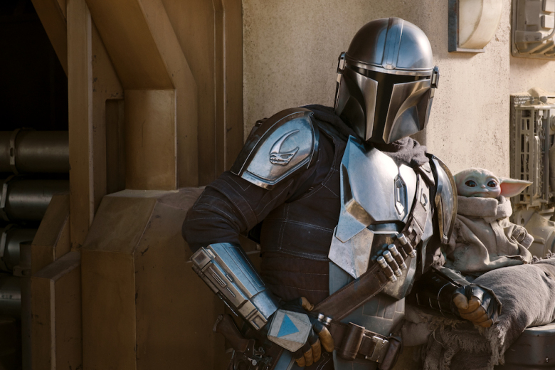 The Mandalorian (Pedro Pascal) and the Child in THE MANDALORIAN, season two, exclusively on Disney+. Image courtesy of Indie Wire.
